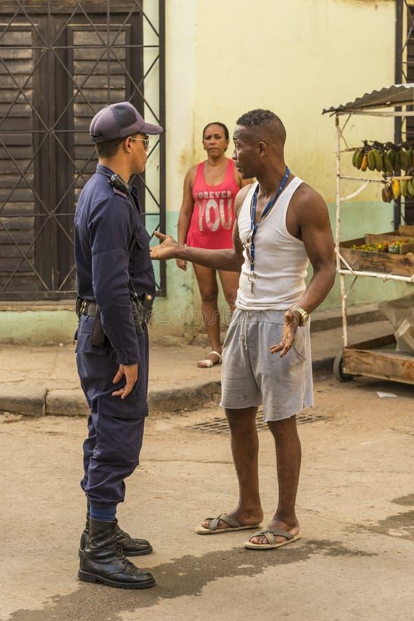 Street vendor man talking to police officer Havana royalty free stock photography