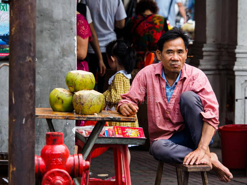 A street vendor selling coconut water stock photography