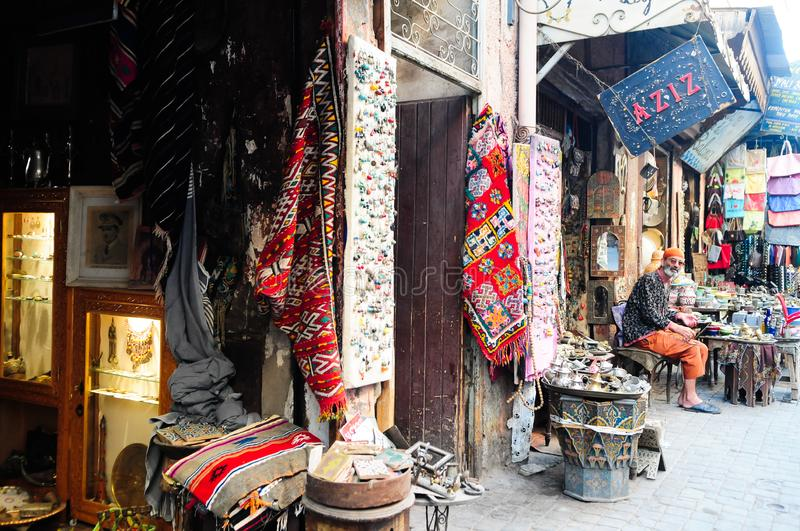 Street vendor selling crafts at Souk Marrakech royalty free stock photo