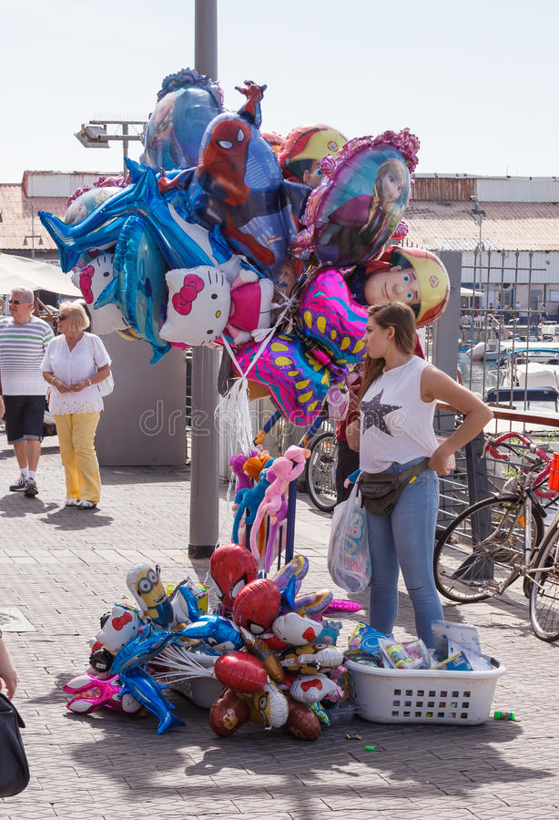 Street vendor sells balloons on the waterfront in Yafo, Israel. Yafo, Israel, October 15, 2016: Street vendor sells balloons on the waterfront in Yafo, Israel royalty free stock photo