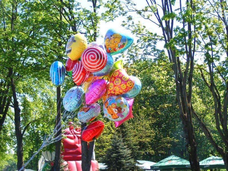 Street vendor sells colorful popular cartoon character helium balloons. Street vendor sells colorful popular cartoon character balloons royalty free stock photo
