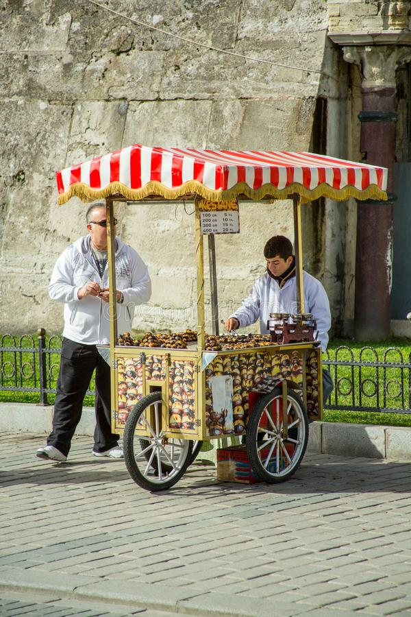 A street vendor sells food in Istanbul. On a sunny, but cold day in Istanbul a street vendor sells food items royalty free stock image