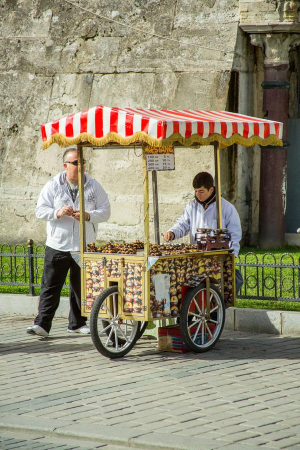 A street vendor sells food in Istanbul. On a sunny, but cold day in Istanbul a street vendor sells food items stock images
