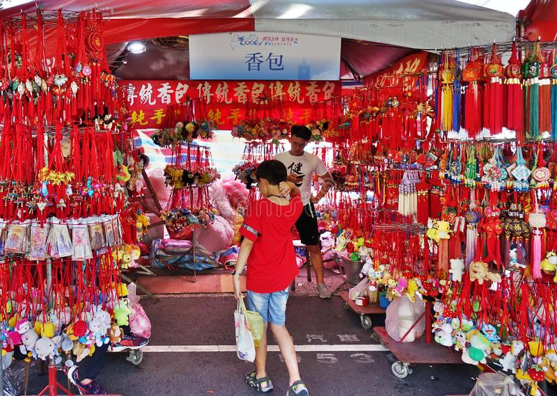A Street Vendor Sells Scented Sachets. KAOHSIUNG, TAIWAN -- JUNE 7, 2019: A street vendor sells scented sachets in various shapes and designs royalty free stock photography