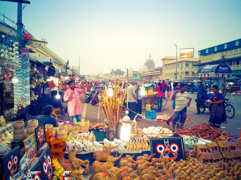Street vendor sells traditional souvenirs on Grand Road in Puri. Orissa, India royalty free stock image