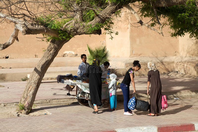 Street vendor in Taroudant. Morocco: street vendor and local people outside the Taroudant's defensive wall. Taroudant is a Moroccan city located in the Sous stock photo