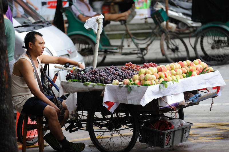 Street vendors. Is selling fruit in Meishan,Sichuan,China stock photos