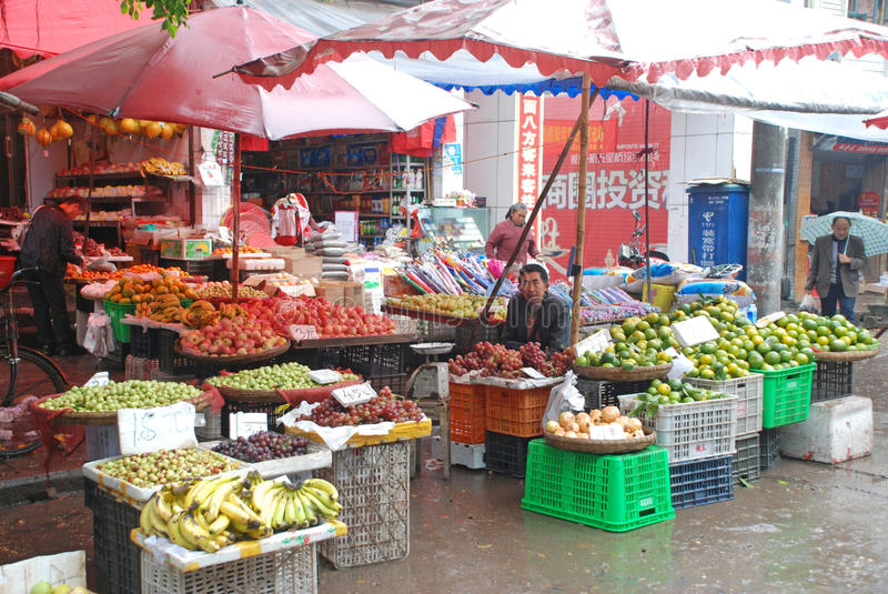 Street vendors. Is selling fruit in dayin,Sichuan,China stock photography