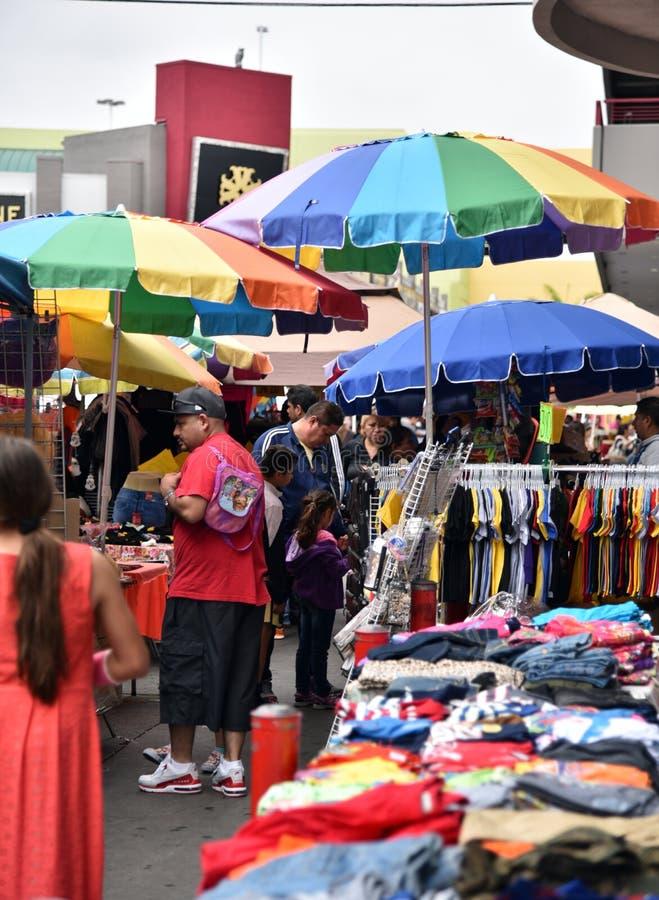 Street Vendors in the LA Fashion District. LOS ANGELES, CA/USA - JUNE 19, 2017:  Street vendors and bargain hunters crowd the Los Angeles Fashion District stock photo