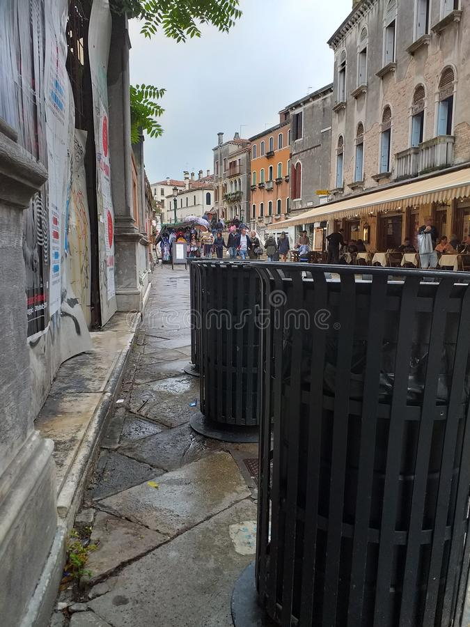 A street or street in Venice with garbage bins in the foreground. stock image