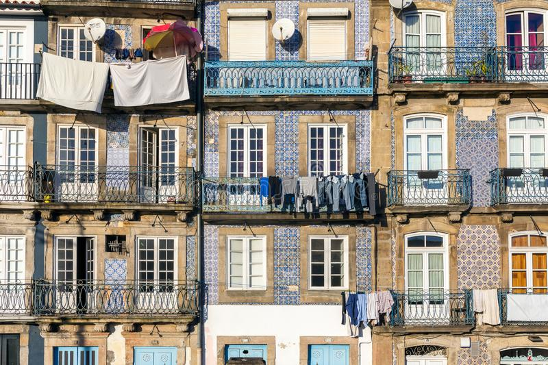Street view on the beautiful old buildings with portuguese tiles azulejo on the facades in Porto stock image