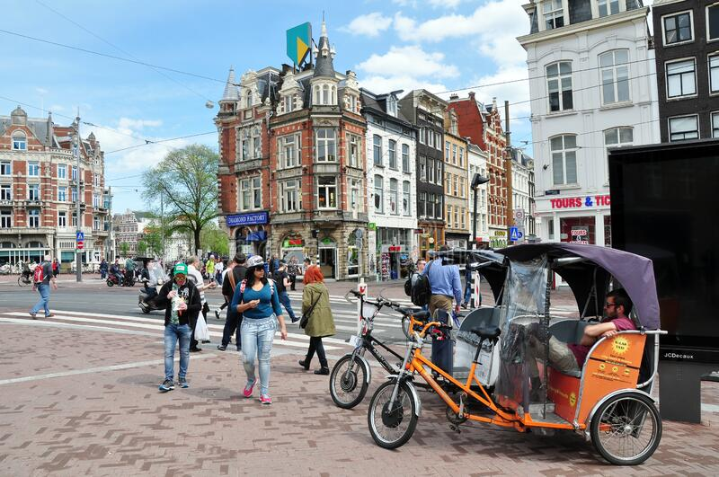 Street view on the busy Muntplein square, Amsterdam, the Netherlands stock image