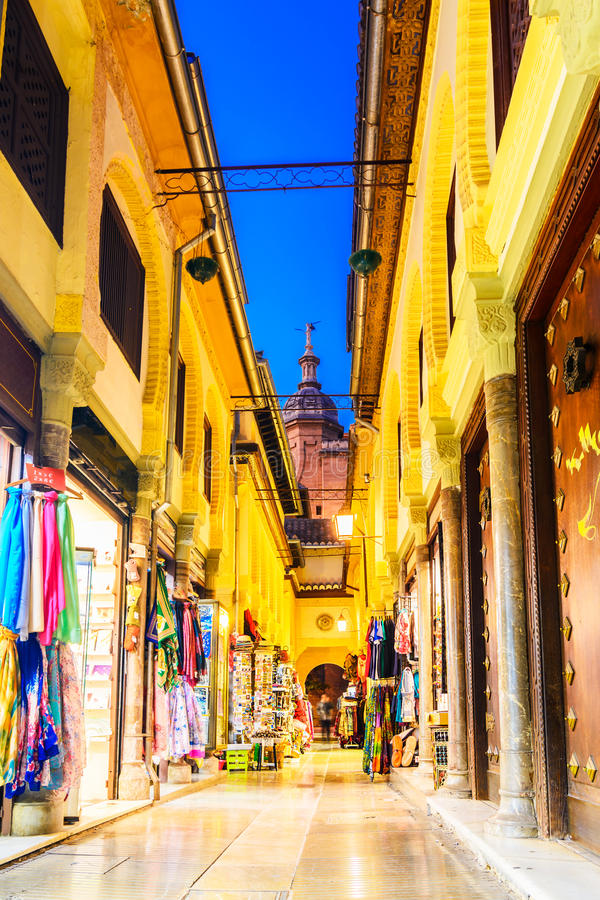 Street view with Cathedral of the Incarnation main tower, Granada,Andalusia, Spain royalty free stock photos