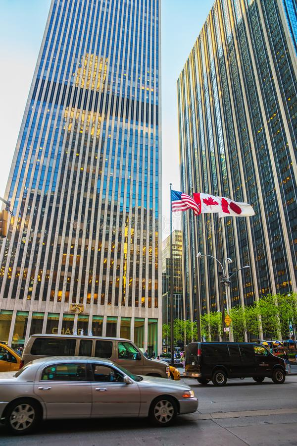 Street view on Exxon Building and TimeLife Building NYC. New York, USA - May 6, 2015: Street view on Avenue of the Americas and Exxon Building and Time-Life stock image