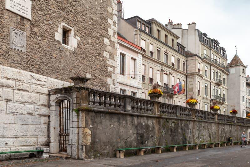 Street view of Geneva, Switzerland. Geneva, Switzerland - November 26, 2016: Street view of Geneva city with old stone houses. Ordinary people walk the street royalty free stock images