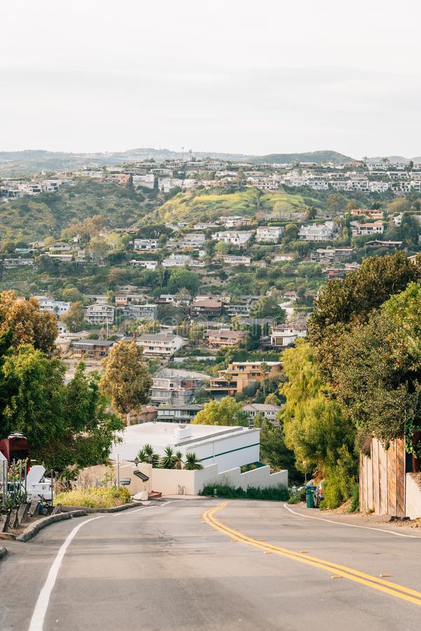 Street and view of hills in Laguna Beach, Orange County, California.  royalty free stock images