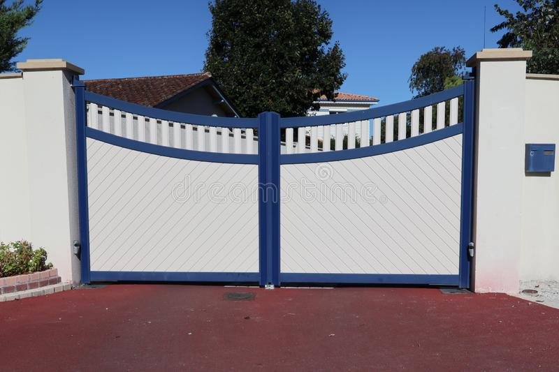 Street view large modern wood blue and white gate house. A street view large modern wood blue and white gate house stock image