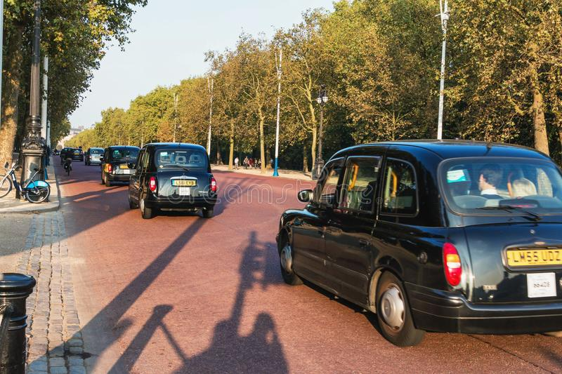 Street view of london. Black car - taxi. England. Editorial. stock photo