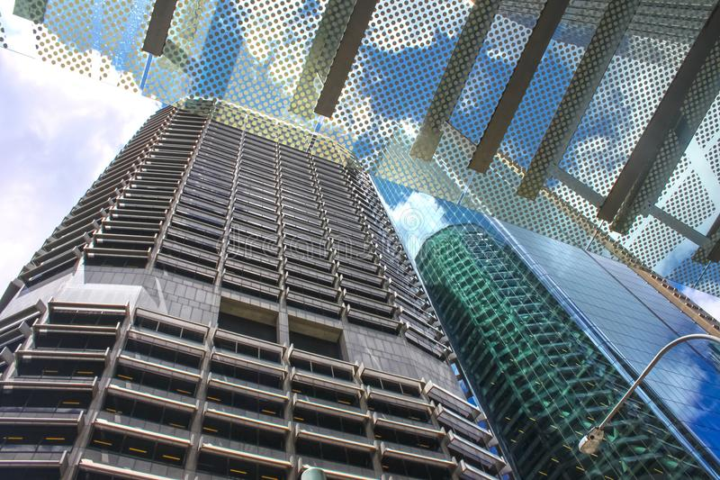 Street view looking up through overhang at reflections in buildings and clouds in blue sky in Brisbane Australia stock photography