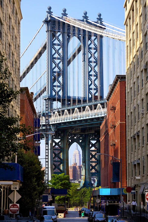 Street view of Manhattan Bridge. Manhattan Bridge and Empire State Building seen from Brooklyn, New York royalty free stock photography