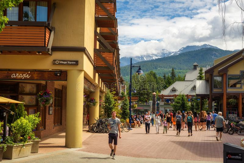 Street view with many tourists in Whistler Village. WHISTLER, BRITISH COLUMBIA, CANADA - JULY 2, 2017 : Scenic street view with many tourists in Whistler Village stock photos