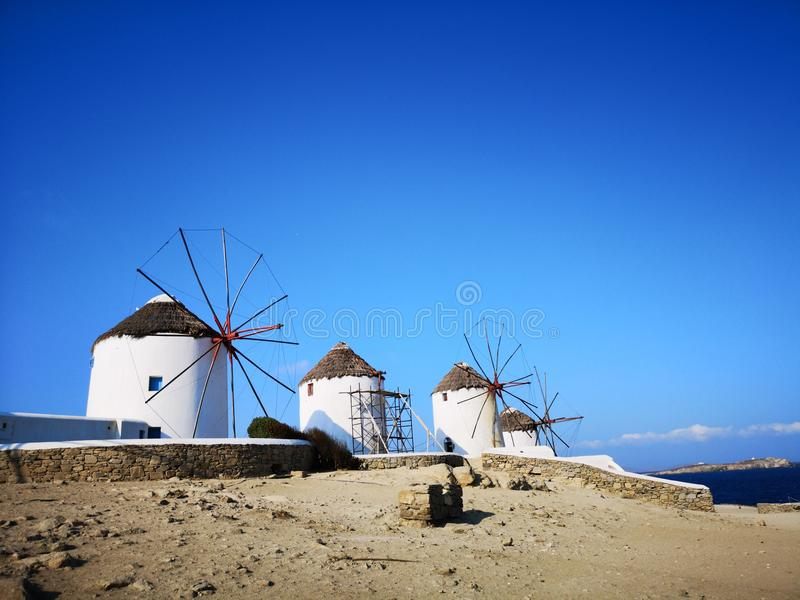 Windmills in Miconos greek island. Street view of Miconos greek island. Style life and glamour in the city. Windmills and the sea stock photography