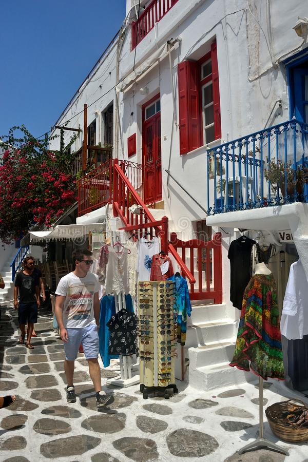 Street view of Mykonos with people walking and tourist shops stock images