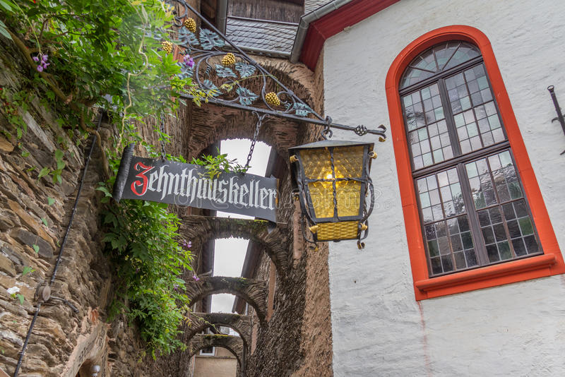 Street view near Zehnthauskeller Bar in Beilstein on river Mosel, Germany. Beilstein, Germany - July 19, 2015: Street view near Zehnthauskeller Bar in Beilstein royalty free stock photography