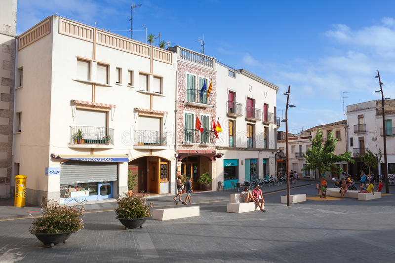 Street view of old part of Calafell, Spain. Calafell, Spain - August 13, 2014: Street view with ordinary people of old part of Calafell, Spanish resort town stock photo
