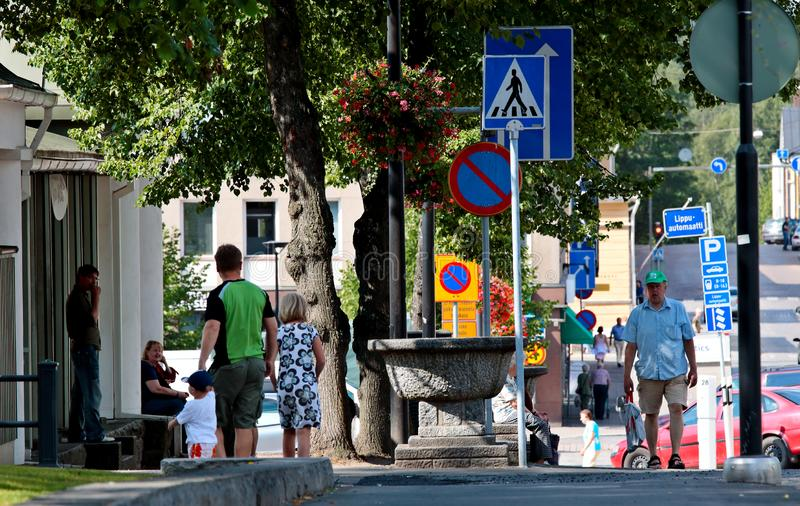 Street view with plenty of different signs and people enjoying the sunny weather in the streets and park royalty free stock photos