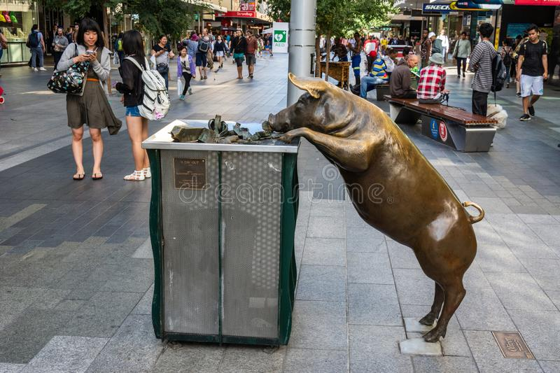 Street view on Rundle Mall pedestrian street in Adelaide, SA, with sculpture of life-size bronze pig, known as Oliver stock images