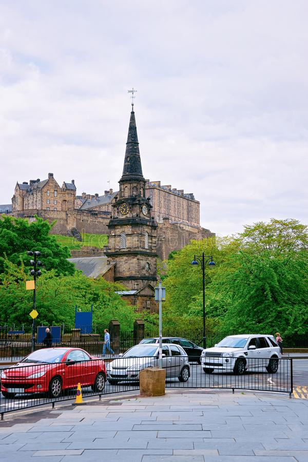 Street view on St Cuthbert Church and Edinburgh Castle in Scotland royalty free stock photo