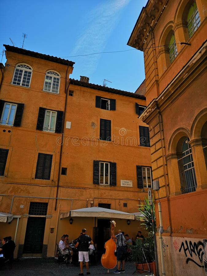 Trastevere neiborhood in Roma, Italy. Street view of Trastevere neiborhood in Roma, Italy. Church, typical buildings facades royalty free stock images