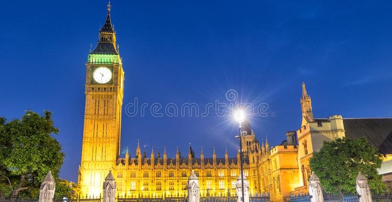 Street view of Westminster Palace at night in London - UK.  royalty free stock images
