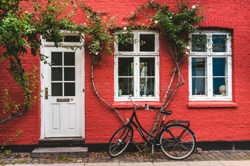 Street, wall and bike in Copenhagen stock photo