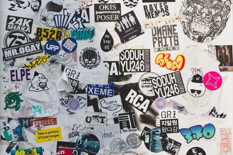Download street wall covered numerous multicolored stickers editorial stock photo image of wall