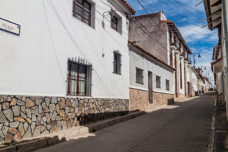 Street with white houses in Sucre, capital of Bolivi. A royalty free stock image