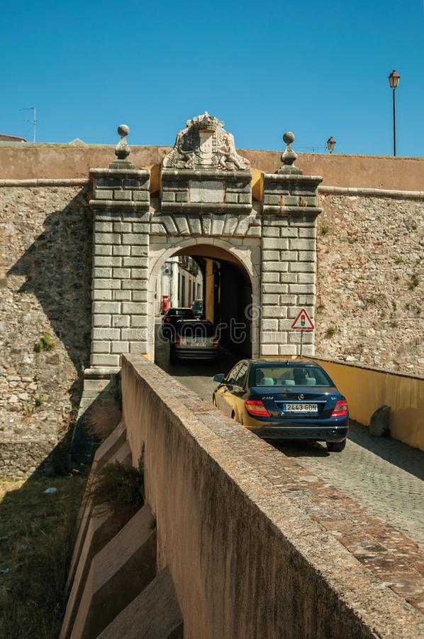 Street wit cars entering the city wall gateway royalty free stock photos