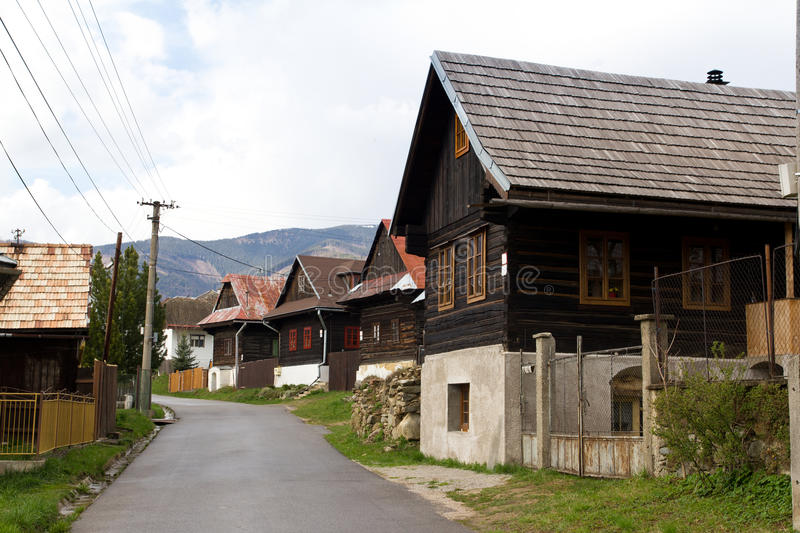 Street with wooden houses. Street with several wooden homes in central Slovakia royalty free stock images
