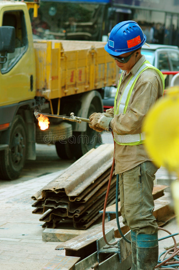 Street Worker using torch for stock photography
