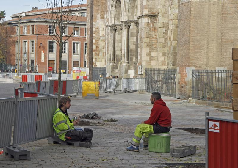 Street workers are taking a minute of rest outdoors. Toulouse, France - December 4, 2018: street workers are taking a minute of rest outdoors in Toulouse, France stock photo