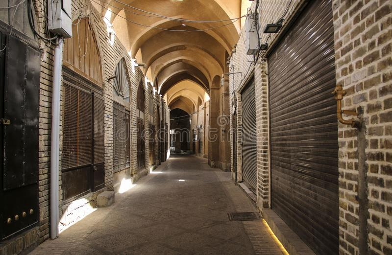 Street of the Yazd Khan bazar empty and deserted, in a covered a. Lley of the market. Symbol of Persian architecture, it`s a major landmark of the city Yazd royalty free stock image