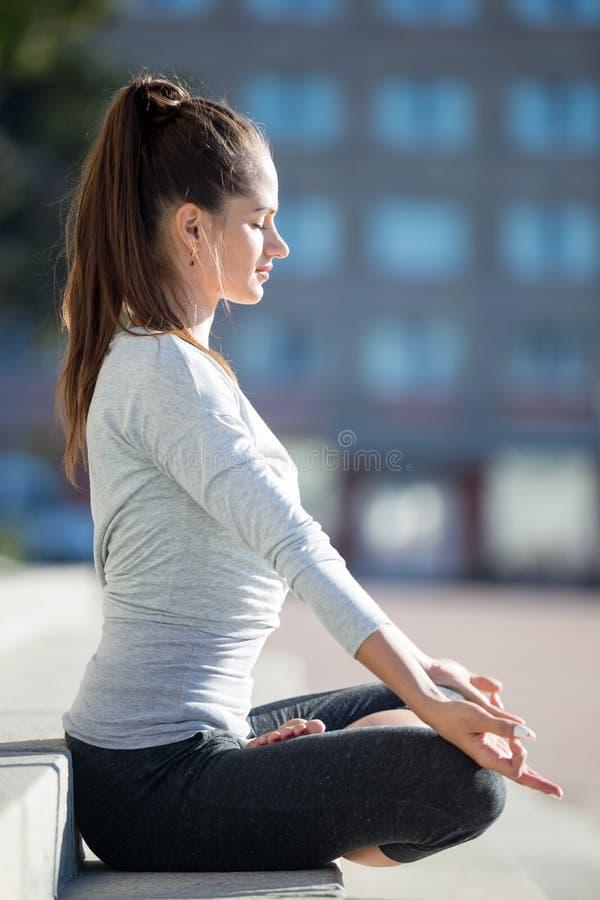 Street yoga: Half Lotus Pose royalty free stock images
