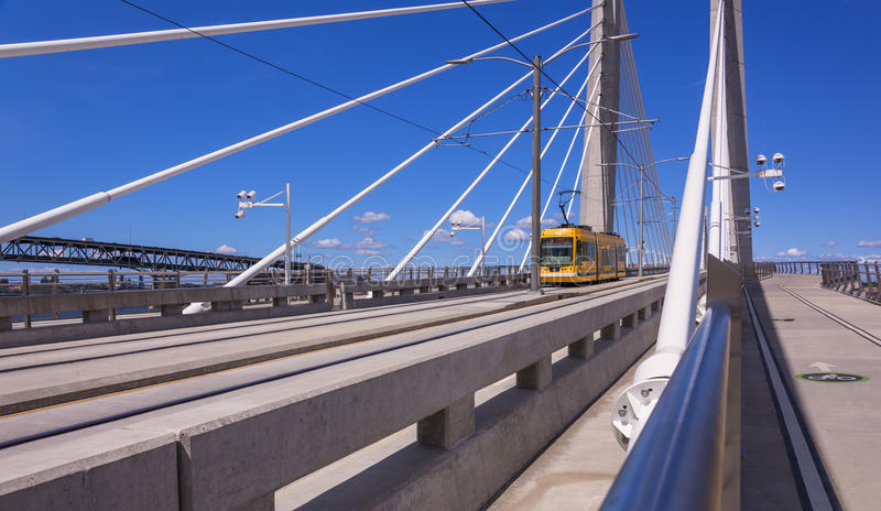 Streetcar on Tilikum Crossing in Portland. Tilikum Crossing or Bridge of the People is a cable=stayed bridge across the Willamette river. It is designed for Max stock image