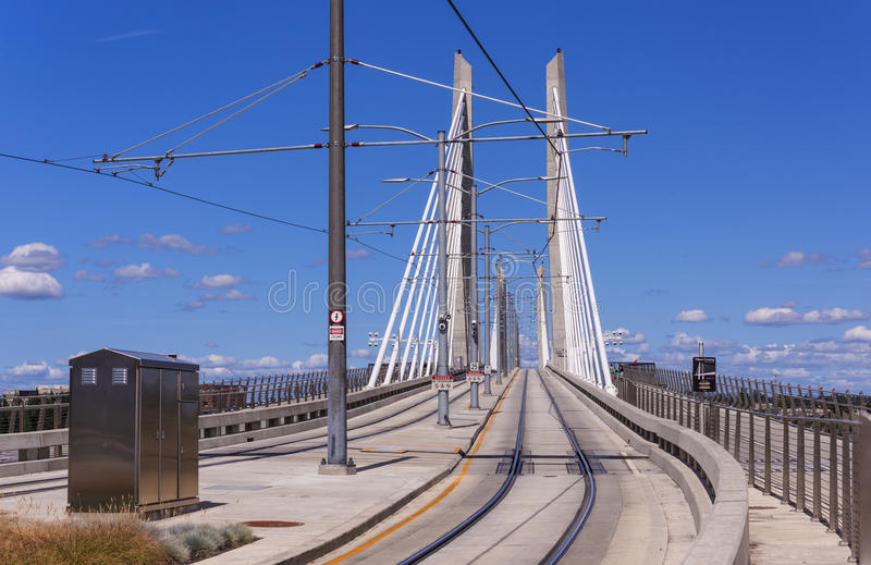 Streetcar on Tilikum Crossing in Portland. Tilikum Crossing or Bridge of the People is a cable=stayed bridge across the Willamette river. It is designed for Max royalty free stock photo