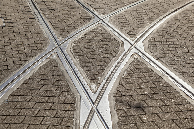 Streetcar or tram rails in old cobble stone street. Rails of streetcar in old cobble stone street royalty free stock images