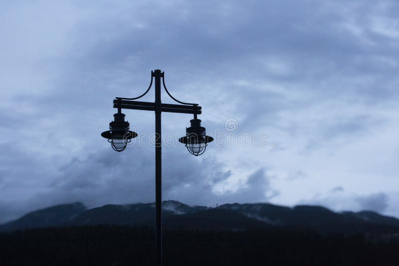 Streetlight with mountain and sky background stock photography