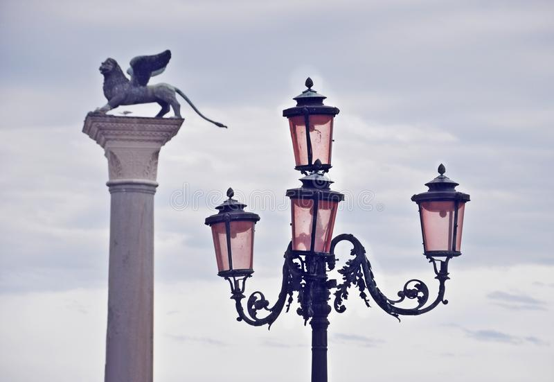 Streetlight and Winged Lion Column in St. Mark's Square in Venice royalty free stock image