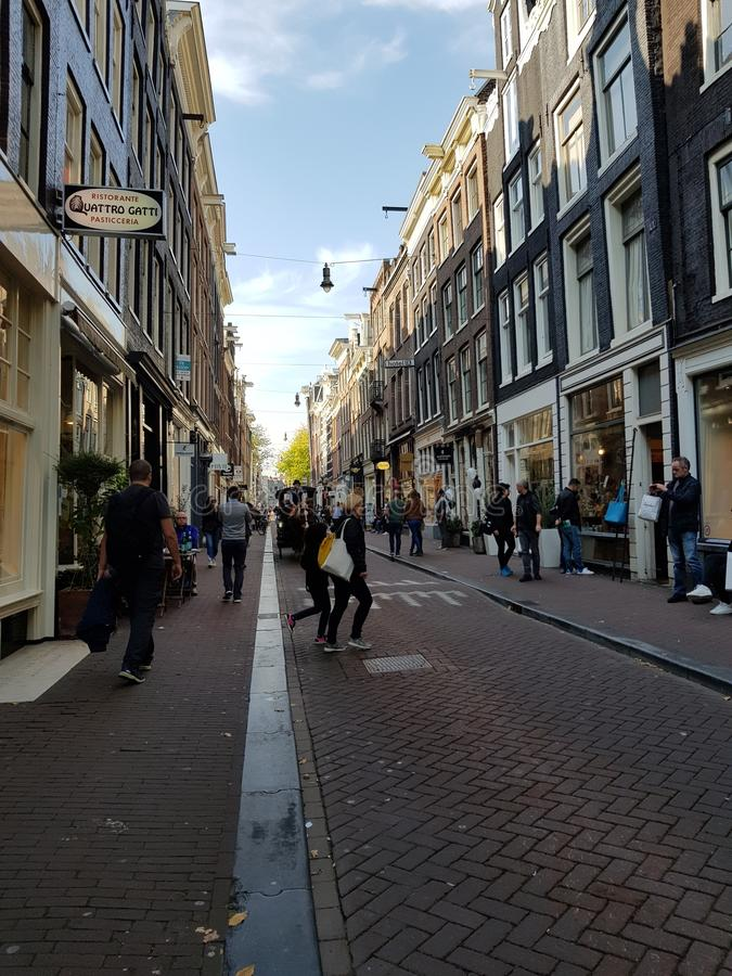 Streets of Amsterdam on a sunny bright day royalty free stock images