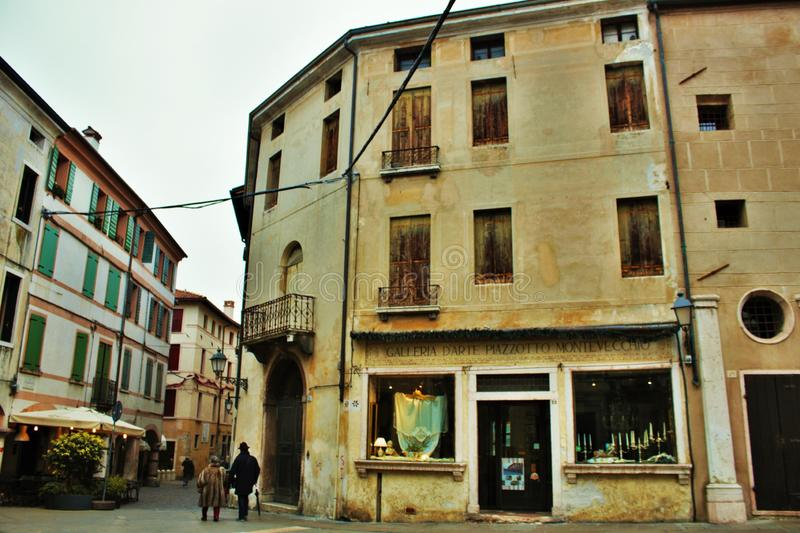 In the streets of bassano del grappa, palaces and churches with squares of the beautiful town.  royalty free stock image